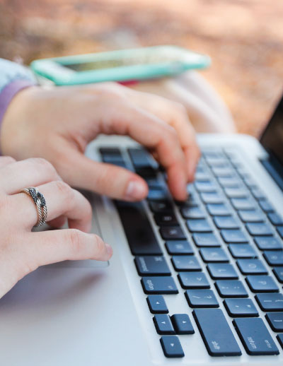 close up of person typing on laptop