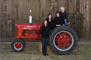 Lenny Mendonca and family around tractor